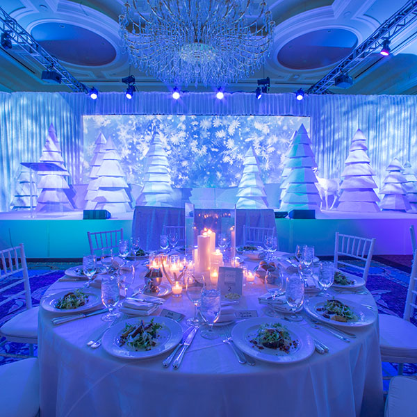 Domo 2016 Holiday Party Decor and Table Settings. White custom built Christmas Trees.